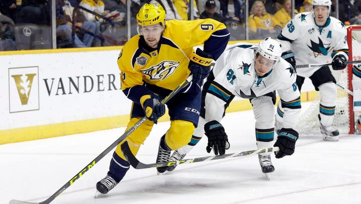 Nashville Predators center Filip Forsberg (9) moves the puck ahead of San Jose Sharks defenseman Justin Braun (61) and center Logan Couture (39) in the second period.