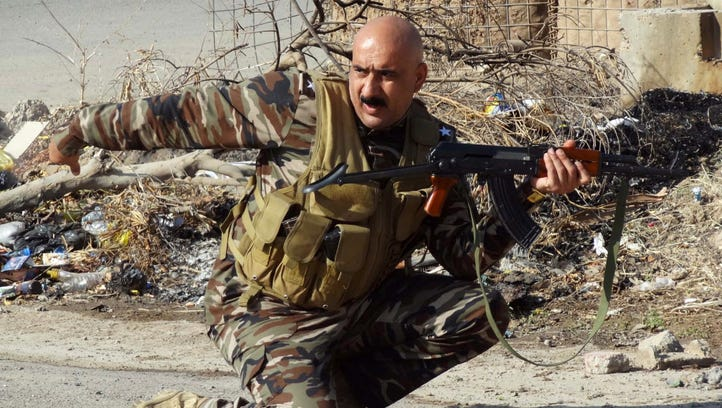 A member of the Iraqi Kurdish security forces takes