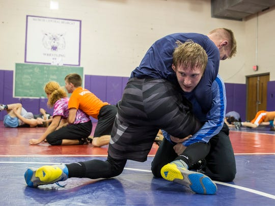 Cory Cooper practices his wrestling technique durng practice Monday morning at Central High School. Cooper is one of Central's top wrestlers andhas a 4.6 GPA.