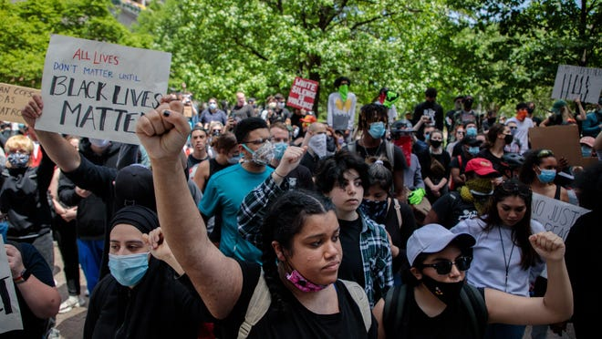 Adrianna Campbell, 16, center, raises her fist Monday in Columbus, Ohio, as protests continue following the death of Minneapolis resident George Floyd. Floyd, a 46-year-old black man, was killed while in police custody after allegedly passing a counterfeit $20 bill at a convenience store.