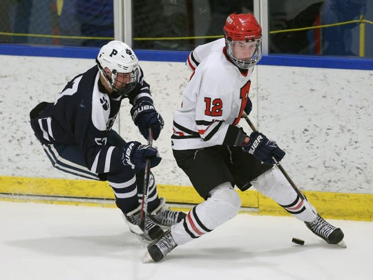 Pittsford's Connor Haims pressures Penfield's Andrew Ebersol (12).