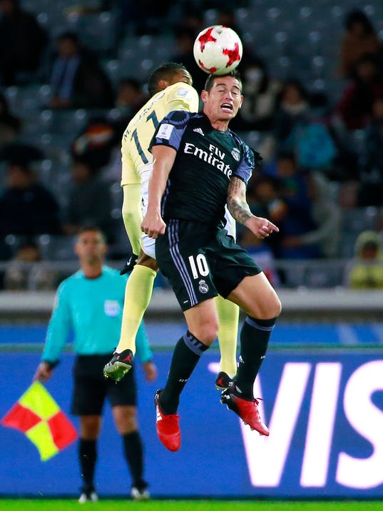 Real Madrid's James Rodriguez (10) and Club America's Michael Arroyo vie for the ball in the air during their semifinal match at the FIFA Club World Cup soccer tournament in Yokohama, near Tokyo, Thursday, Dec. 15, 2016. (AP Photo/Shizuo Kambayashi)