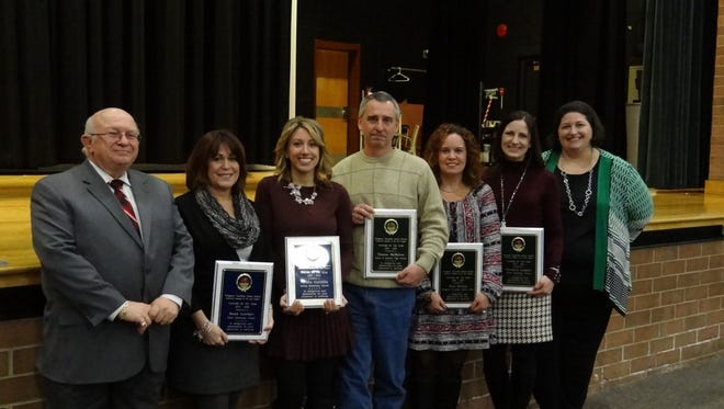 Pittsgrove Township School District 2015-2016 Teachers of the Year were recognized by  Superintendent Henry Bermann (left) and Board of Education President Carrie Mullin (right). The honorees (from left) were Susan Lewbart, Natalie Carrozza, Tom McMahon, Julie Suwala and Christine Laspata.