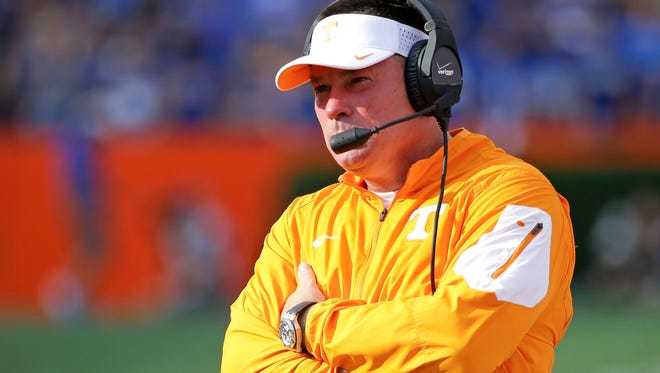 Tennessee head coach Butch Jones watches his team during the first half of an NCAA college football game against Florida, Saturday, Sept. 26, 2015, in Gainesville, Fla.