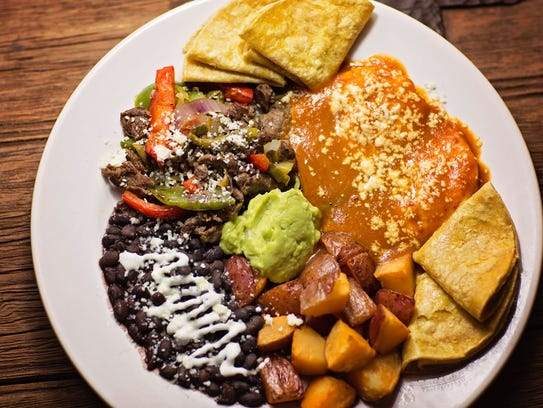 Huevos rancheros at Senor Tomas come with black beans,