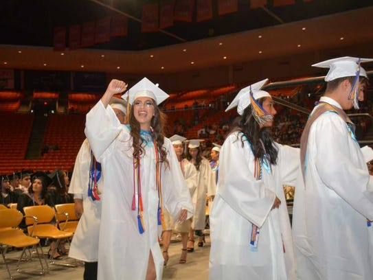 Ashley Vila, top 10 percent graduate from Chaparral High School, waves to family and friends as she prepared to receive her diploma on Saturday, May 26, 2018, at the Don Haskins Center in El Paso.