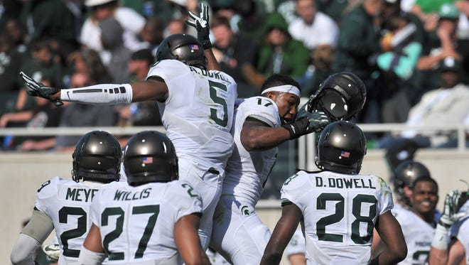 White team players including Andrew Dowell (5) and David Dowell (28) celebrate taking the ball away from the Green team on the last drive of the game.