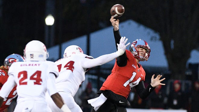 Western Kentucky quarterback Mike White throws a pass during Saturday's game against Florida Atlantic in Bowling Green, Ky.