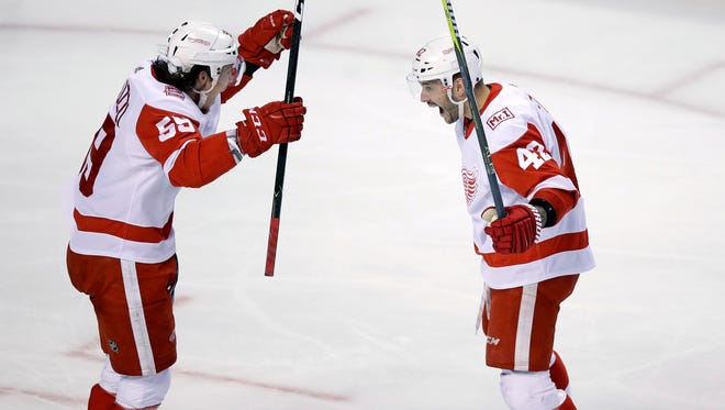 Martin Frk, right, celebrates his goal with Tyler Bertuzzi during the third period against the Bruins on Tuesday.