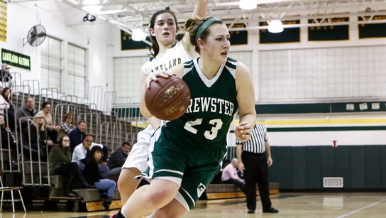 Brewster's Julia Borsari (23) drives the baseline during