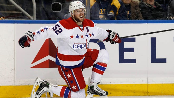 Washington Capitals defenseman Mike Green (52) celebrates after scoring the winning goal against the Buffalo Sabres during the overtime period at First Niagara Center.