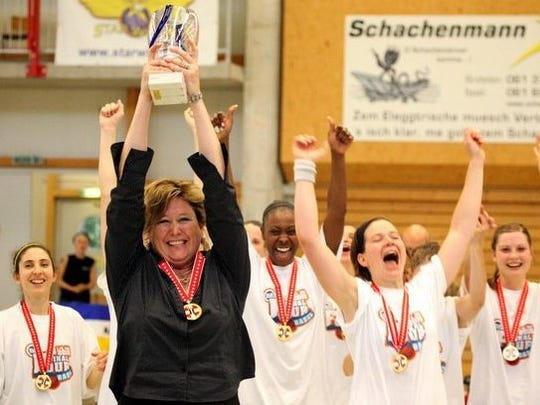 Ina Nicosia-Schelker, a 1990 Vineland graduate, celebrates after coaching the University of Basel to a championship in 2010.
