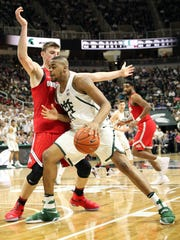 Michigan State forward Nick Ward (44) dribbles the ball as Ohio State center Micah Potter (0) defends during the second half of MSU's 74-66 win Tuesday at Breslin Center.