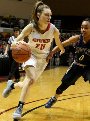 Jackson Northwest's Sydney Shafer (20) drives towards the basket as Birmingham Detroit Country Day's Kaela Webb (0) defends during the first half of the Class B state final in Grand Rapids on Saturday, March 17, 2018.
