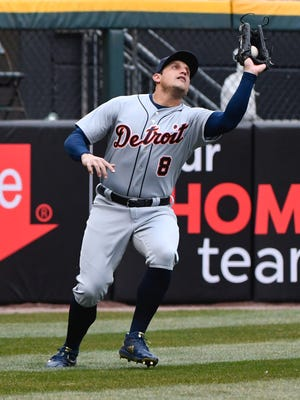 Detroit Tigers left fielder Mikie Mahtook (8) catches a fly ball hit by Chicago White Sox first baseman Jose Abreu (79) in the first inning at Guaranteed Rate Field on April 5, 2018.