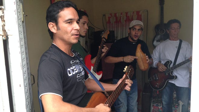 Members of the Grupo Agape band practice in the living room of a small house in San Francisco de Paula, about 10 miles from downtown.