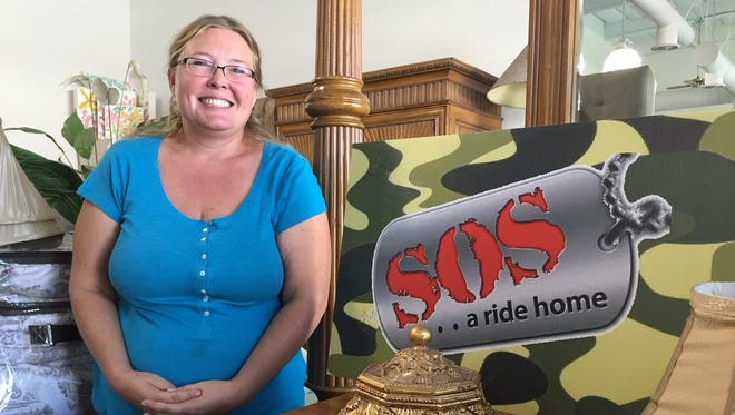 Erica Stone, founder of SOS, at the organization's new headquarters, resale boutique and veterans communication center in Palm Desert.