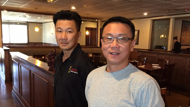 Doug Yi, left, and Peter Lieu, plan to open a new restaurant concept, OTTO Izakaya, in Greenville in the spring.