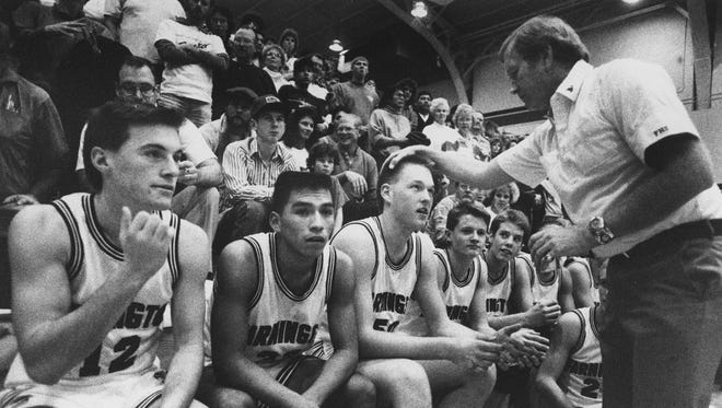 Marv Sanders talks to a Farmington High player during a game on Dec. 13, 1989.