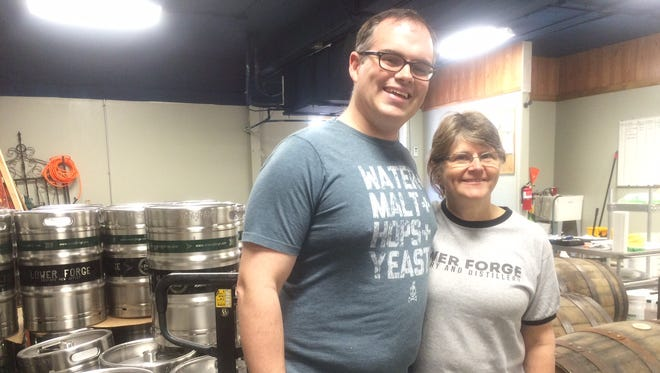 Lower Forge brewers Sean Galie and his mother, Pola Galie, get ready for Thursday's brewery launch.