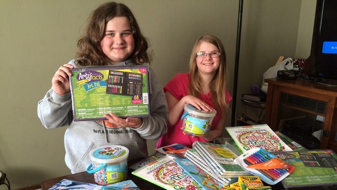 Ellen Tellstrom, left, and Kaitlyn Leonardson are collecting art supplies for hospitals in Wisconsin and Minnesota.
