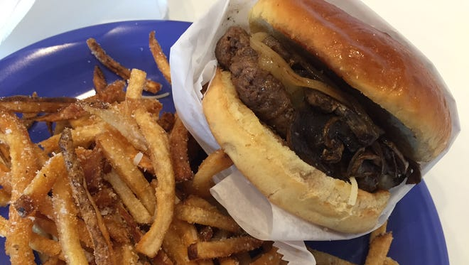 The 1/3-pound Alpine burger and parmesan fries at Bones' Burgers in Montgomery