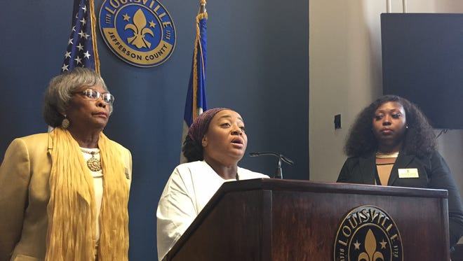 Metro Councilwomen Mary Woolridge, left, and Jessica Green, right, with west Louisville resident Eboni Cochran on Friday.
