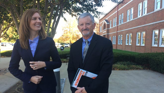 The Rev. Ellen Di  Giosia, senior pastor of First Baptist Church of Jefferson City, and John McGraw, the church's chair of deacons, stand outside First Baptist Church, Hendersonville following Tuesday's vote by the Tennessee Baptist Convention. The statewide church body declined to permit representatives from the East Tennessee church to vote during its annual business meeting.