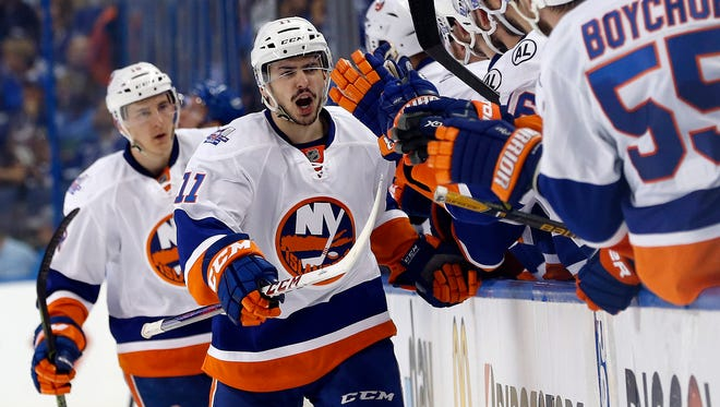 Islanders center Shane Prince is congratulated after scoring a goal against the Lightning during the first period.