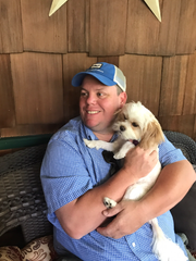 Tom Fordet of New City with Ginger, his family's cavapoo.