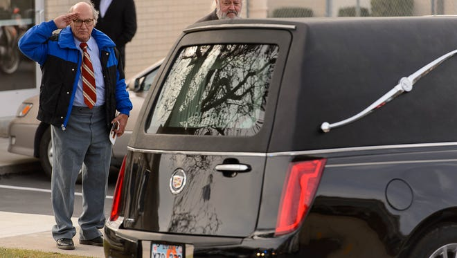 George Zinn salutes the hearse following the funeral of former Utah Gov.Olene Walker in Salt Lake City on Friday, Dec. 4, 2015. Utah's political leaders and several hundred mourners gathered Friday to remember Walker as a tough, warm and straightforward woman who served as the state's first and only female governor.