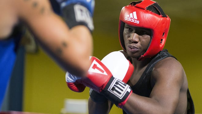 Hard work and focus paid off for E'Mond Driver Thursday night at the annual Indiana Golden Gloves boxing tournament at Tyndall Armory. ,
