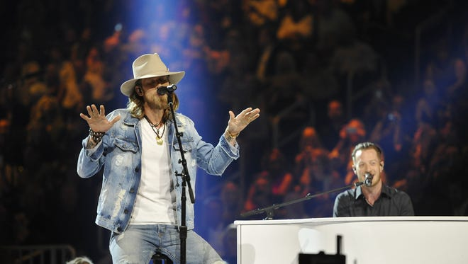 Brian Kelley, left, and Tyler Hubbard of music group Florida Georgia Line perform during the 52nd Academy of Country Music Awards at T-Mobile Arena on Sunday, April 2, 2017, in Las Vegas, Nev. Larry McCormack / Tennessean.com