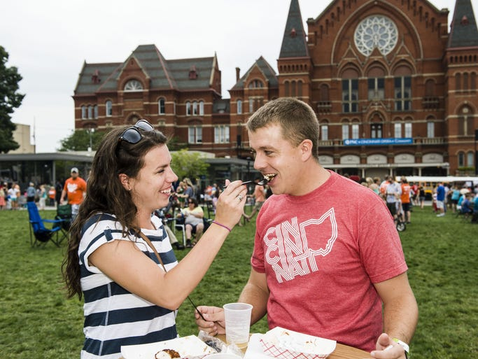 Tender Mercies hosted the second annual Taste of OTR in Washington Park. Molly and Eric Ihlendorf of Deer Park share the Chicken & Waffles from Taste of Belgium.