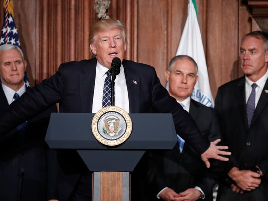 President Donald Trump speaks at EPA headquarters on March 28, 2017, before signing an executive order on energy and climate. Behind him (left to right) are Vice President Mike Pence, Environmental Protection Agency Administrator Scott Pruitt and Interior Secretary Ryan Zinke.