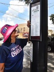 Marie Renaud looks over one of the three new pedestrian kiosks in downtown Opelousas that will offer visitors information on historic sites and points of interest. The project was funded through a $5000 dollar grant secured by Opelousas Tourism and Main Street.