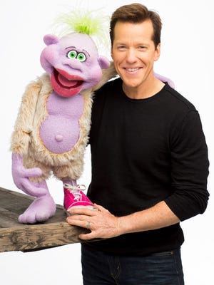 Comedian and ventriloquist Jeff Dunham stands with his character, Peanut.