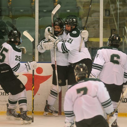 Delbarton players celebrate their goal. Delbarton dominates Bishop Eustace to win the ice hockey in Non-Public semifinals 8-2 Friday night at Richard D. Codey Arena, South Orange, NJ. Friday, March 6, 2015.