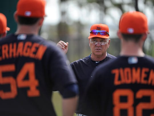 Rich Dubee talks with his pitchers earlier this week in Lakeland.