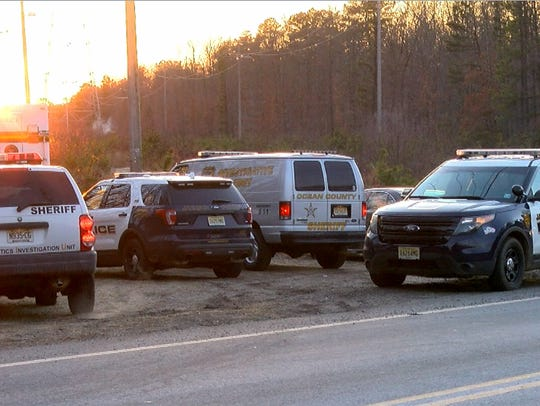Police vehicles line South Stump Tavern Road in Jackson