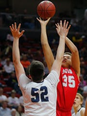 Dubuque Senior's Noah Carter goes up for a shot while being guarded by Pleasant Valley's Carter Milam during the Class 4A Iowa Boys' High School State Basketball Tournament at Wells Fargo Arena in Des Moines, Wednesday, March 9, 2016.