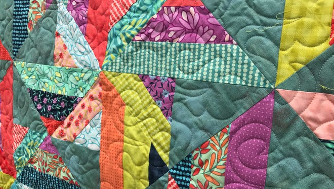 A close-up of a quilt made by Jud Beall.