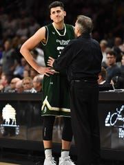 CSU coach Larry Eustachy talks to Nico Carvacho during the Rams' win Wednesday night in Boulder over the University of Colorado. Carvacho, a redshirt freshman, scored 14 points and pulled down nine rebounds in the game.