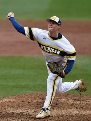 Michigan's Jacob Cronenworth delivers against Maryland during the ninth inning of the NCAA Big Ten tournament championship college baseball game Sunday, May 24, 2015, in Minneapolis.