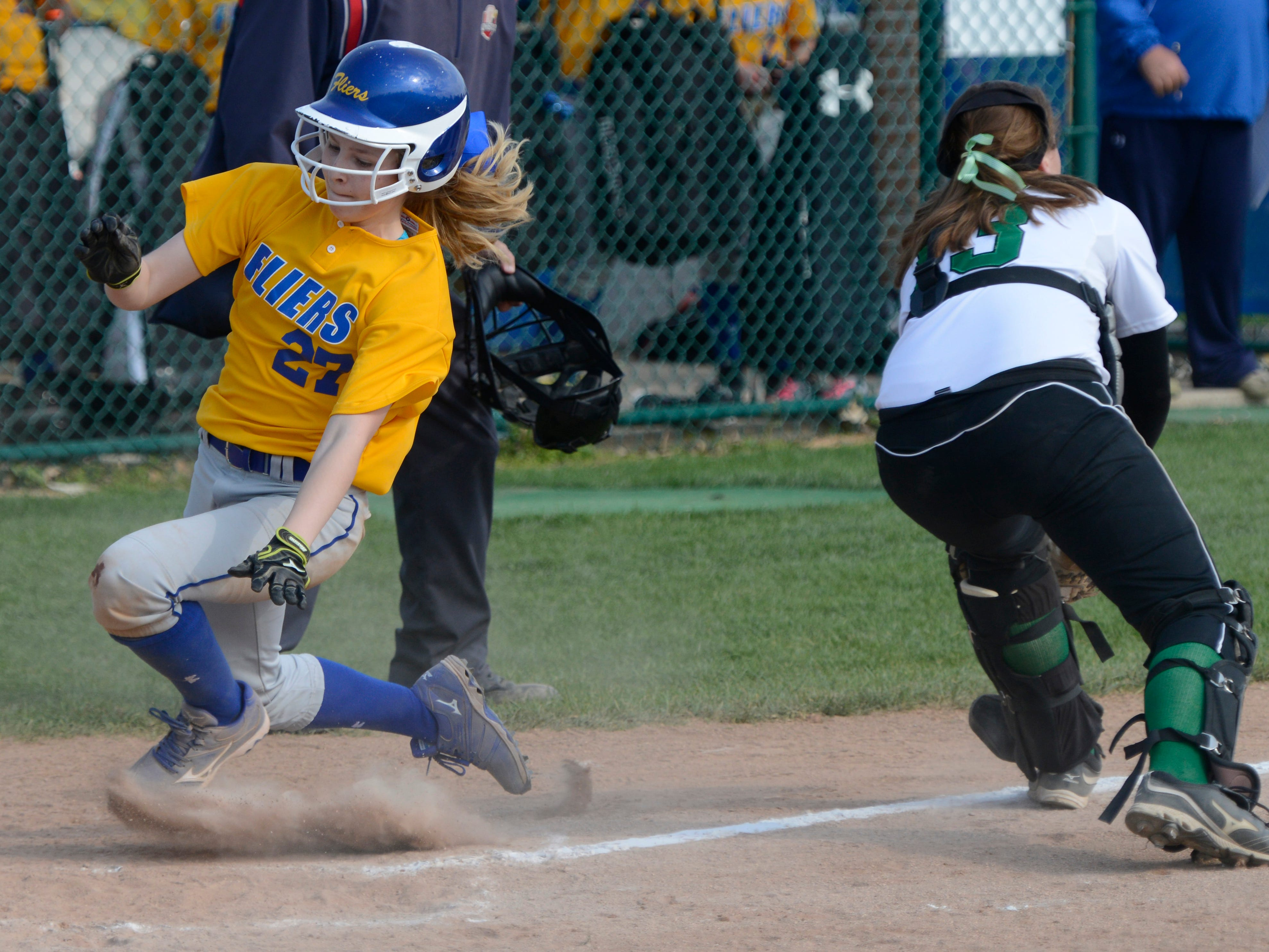 Clyde's Heidi Marshall gets past Margaretta's catcher Jess Hamm to score in the second inning.