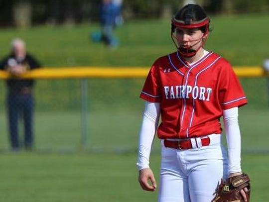 Fairport pitcher Clare Aroune is a third-year varsity player who also plays third base. Her father, Jim, is a former television news anchor.