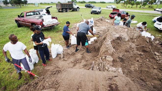 Residents of Clewiston pack dirt into sandbags Thursday, Oct. 6, 2016 in advance of Hurricane Matthew. The rural town is bracing for potential flooding from Lake Okeechobee. Kinfay Moroti/The News-Press