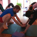 """Karma Yoga is holding an all-day """"Yogathon"""" on Sunday."""