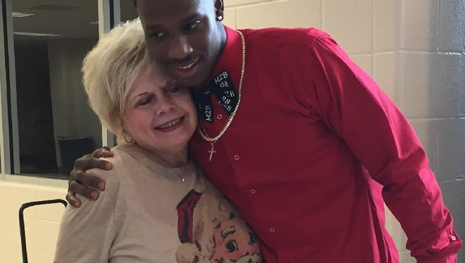 Parkway wide receiver shares a hug  with Parkway assistant principal Becky Gray prior to signing with LSU Friday afternoon.