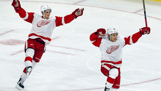 Teemu Pulkkinen, right, celebrates his second goal with teammate Dylan Larkin during the third period.